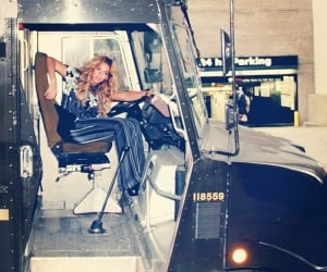 Here's a picture of Beyoncé sitting in what looks like a UPS delivery truck