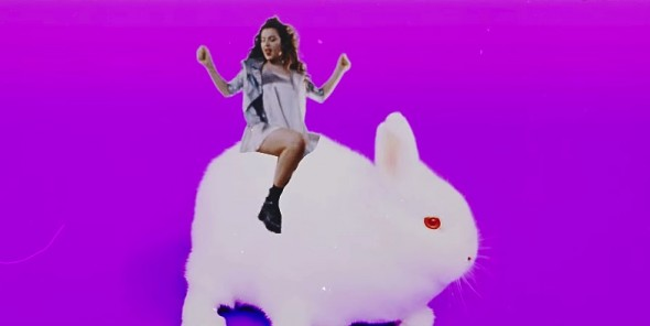 charli xcx straddling an animal